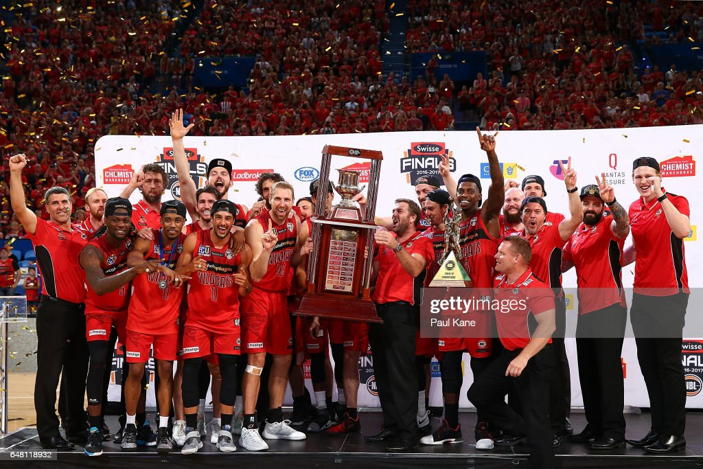 The Wildcats celebrate with the trophy after winning game three and the NBL Grand Final series between the Perth Wildcats and the Illawarra Hawks at Perth Arena on March 5, 2017 in Perth, Australia.