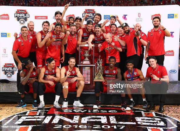 The Wildcats celebrate with the trophy after winning game three and the NBL Grand Final series between the Perth Wildcats and the Illawarra Hawks at...