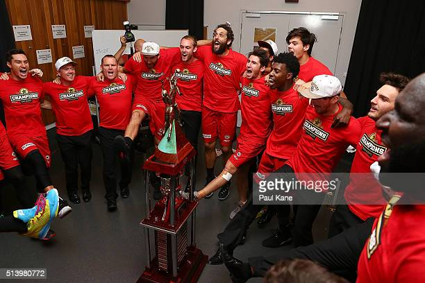 The Wildcats celebrate with the trophy after winning the Championship during game three of the NBL Grand Final series between the Perth Wildcats and...