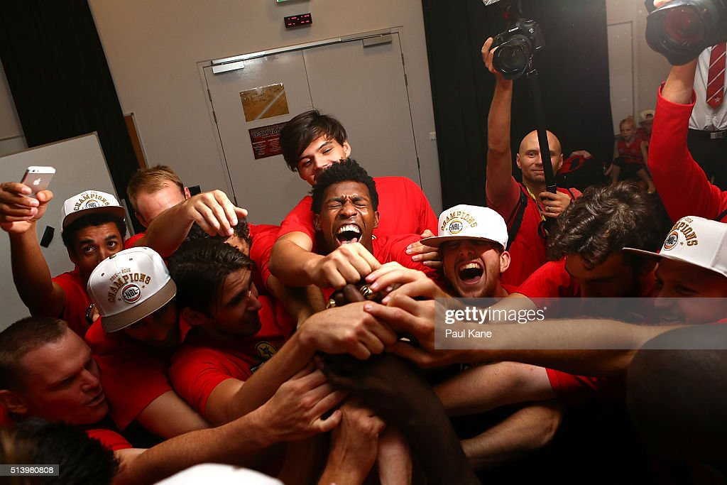 The Wildcats celebrate with the trophy after winning the Championship during game three of the NBL Grand Final series between the Perth Wildcats and the New Zealand Breakers at Perth Arena on March 6, 2016 in Perth, Australia.