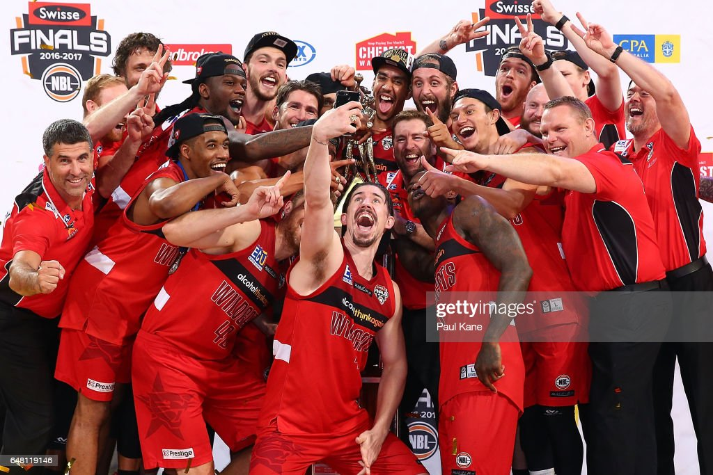 The Wildcats pose for a selphie after winning game three and the NBL Grand Final series between the Perth Wildcats and the Illawarra Hawks at Perth Arena on March 5, 2017 in Perth, Australia.