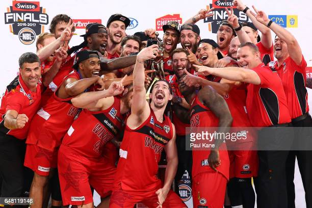 The Wildcats pose for a selphie after winning game three and the NBL Grand Final series between the Perth Wildcats and the Illawarra Hawks at Perth...