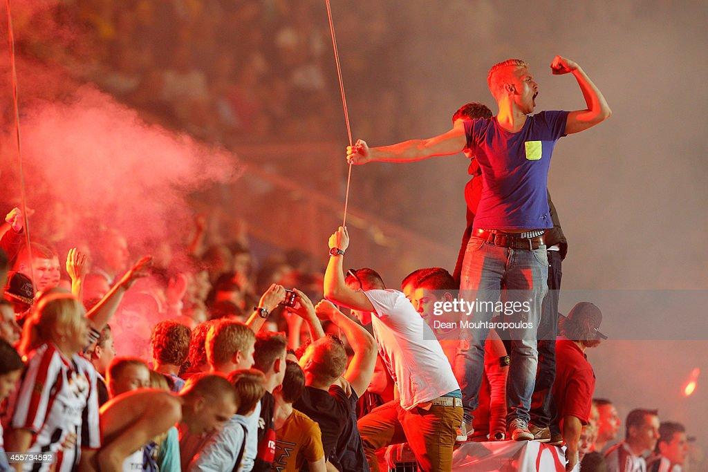 The Willem II fans celebrate victory after the Dutch Eredivisie match between Willem II Tilburg and NAC Breda at Koning Willem II Stadium on September 19, 2014 in Tilburg, Netherlands.
