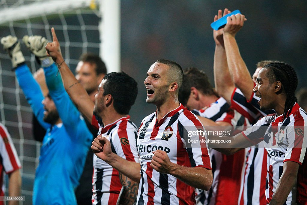 The Willem II players celebrate victory after the Dutch Eredivisie match between Willem II Tilburg and NAC Breda at Koning Willem II Stadium on September 19, 2014 in Tilburg, Netherlands.