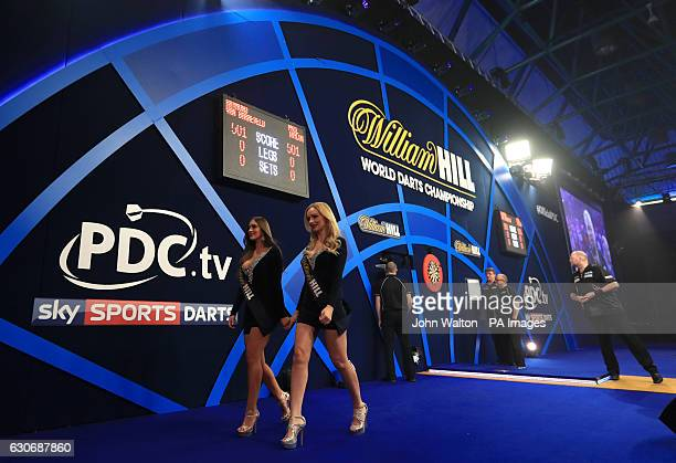 The William Hill oche girls walk off stage before the start of the Raymond van Barneveld and Phil Taylor match during day thirteen of the William...