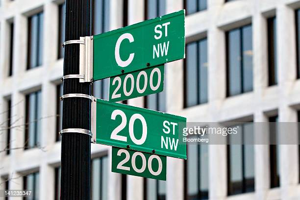 The William McChesney Martin Jr. Federal Reserve building, behind signs, sits at 20th And C Streets in Washington, D.C., U.S., on Tuesday, March 13,...