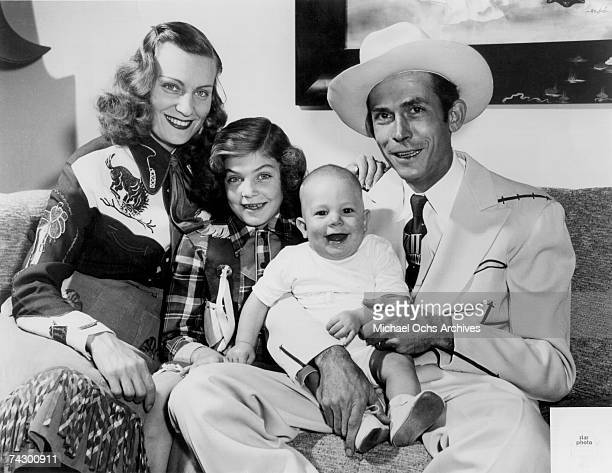 The Williams family Left to Right Audrey Williams, Lycretia Williams, Hank Williams Jr and Hank Williams Sr pose for a portrait in 1949 in Nashville...
