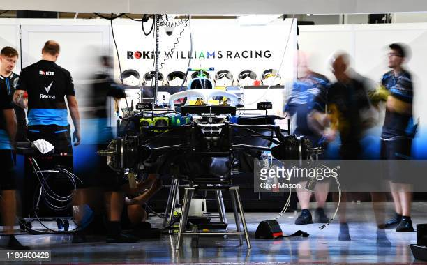 The Williams team work in the garage after practice for the F1 Grand Prix of Japan at Suzuka Circuit on October 11, 2019 in Suzuka, Japan.