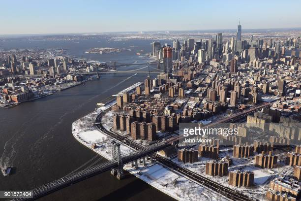 The Williamsburg Bridge stretches into Manhattan on January 5 2018 in New York City Under frigid temperatures New York City dug out from the Bomb...