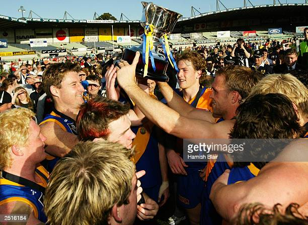 The Williamstown team celebrate their win after the VFL Grand Final between Williamstown and Box Hill played at Optus Oval on September 21 2003 in...