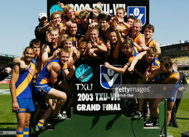 The Williamstown team celebrate their win after the VFL Reserves Grand Final between Williamstown and the Northern Bullants played at Optus Oval on...