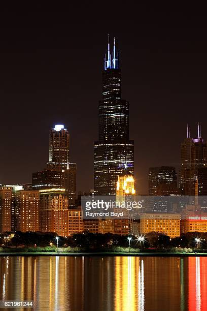 The Willis Tower antennas lights up blue to celebrate the Chicago Cubs' world series win against the Cleveland Indians in Chicago Illinois on...