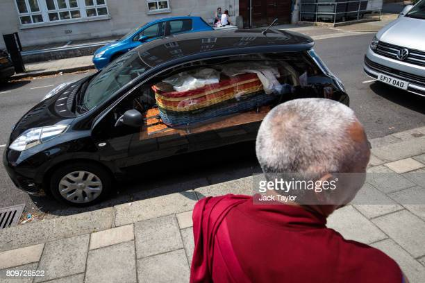 The willow eco coffin of Jon Underwood lies in an electric hearse following the funeral at the Jamyang Buddhist Centre on July 6 2017 in London...