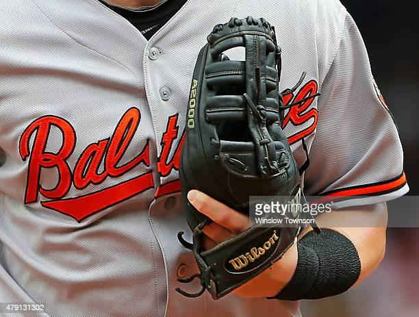 The Wilson baseball glove of Nolan Reimold of the Baltimore Orioles is seen during the fourth inning in a game against the Boston Red Sox at Fenway...