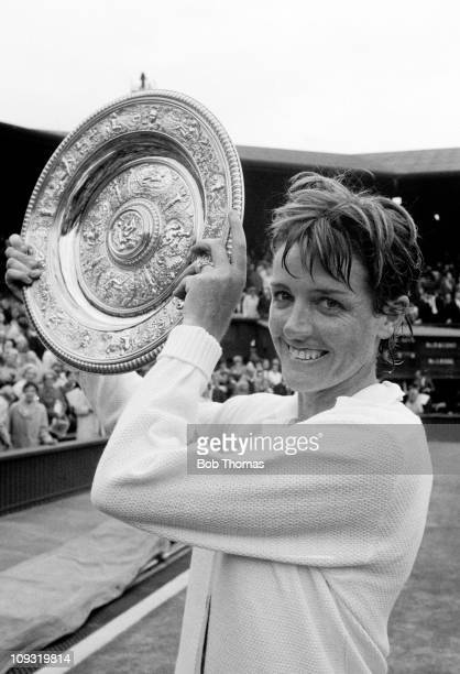 The Wimbledon Ladies Singles Champion Margaret Court of Australia poses with the trophy after defeating BillieJean King on Centre Court at the All...