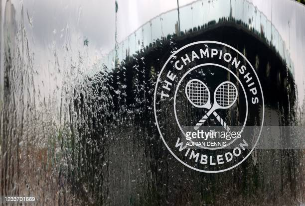The Wimbledon logo is pictured in a water fountain on the first day of the 2021 Wimbledon Championships at the The All England Tennis Club in...