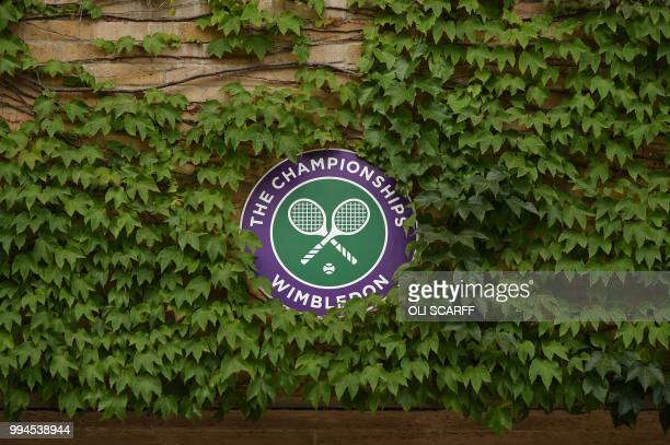 The Wimbledon logo is surrounded by ivy on the seventh day of the 2018 Wimbledon Championships at The All England Lawn Tennis Club in Wimbledon...