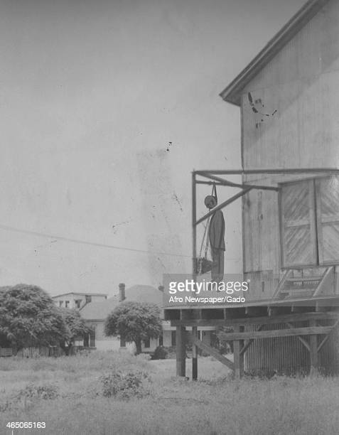 The winch at a cotton gin where an African American man was lynched with an artist's depiction of the lynched man July 2 1942