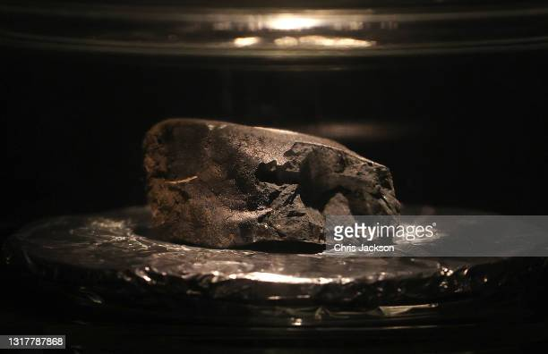The Winchcombe meteorite sits on display at the Natural History Museum on May 13, 2021 in London, England. The meteorite is a rare type, the first to...