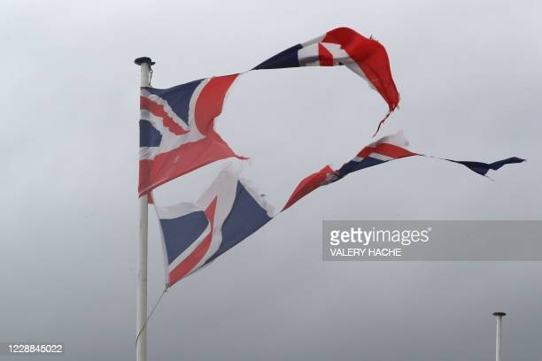 The wind blows into a torn apart Union Jack flag on the Promenade des Anglais avenue in Nice on October 2, 2020 as storm Alex reaches the French...