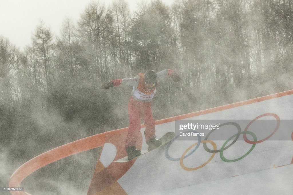 The wind blows snow across the course as a competitor practices before the Snowboard Ladies's Slopestyle Qualification was cancelled due to weather on day two of the PyeongChang 2018 Winter Olympic Games at Pheonix Snow Park on February 11, 2018 in Pyeongchang-gun, South Korea.