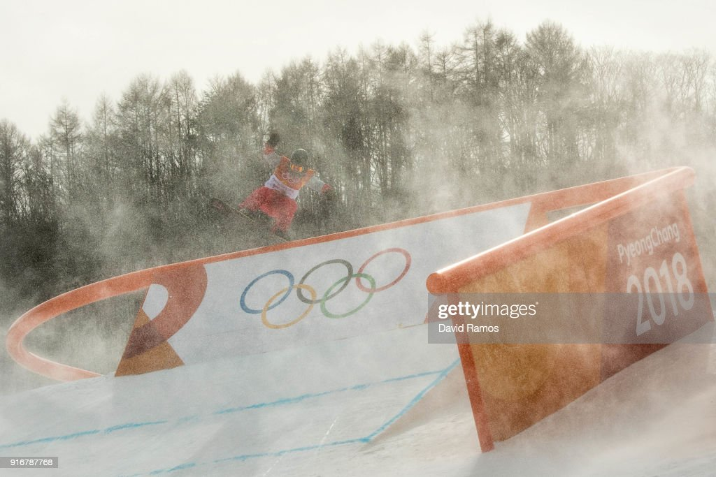 The wind blows snow across the course as competitor practices before the Snowboard Ladies's Slopestyle Qualification was cancelled due to weather on day two of the PyeongChang 2018 Winter Olympic Games at Pheonix Snow Park on February 11, 2018 in Pyeongchang-gun, South Korea.