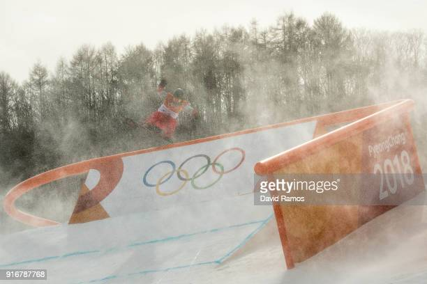 The wind blows snow across the course as competitor practices before the Snowboard Ladies's Slopestyle Qualification was cancelled due to weather on...