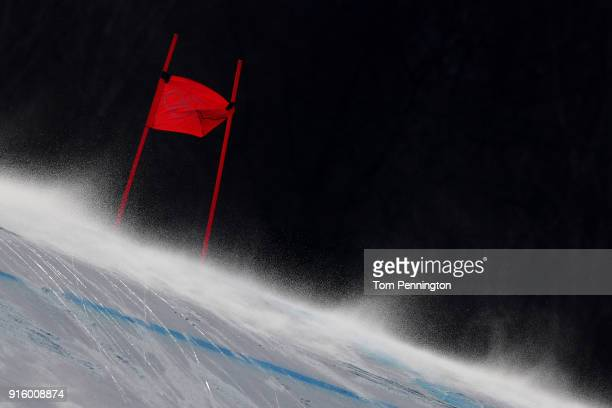 The wind blows snow across the course during the Men's Downhill Alpine Skiing training at Jeongseon Alpine Centre on February 9 2018 in...
