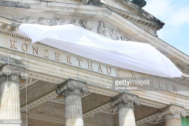 The wind blows tarp showing the new writing 'Konzerthaus Berlin' shortly before the official unveiling ceremony at the Konzerthaus inBerlinGermany...