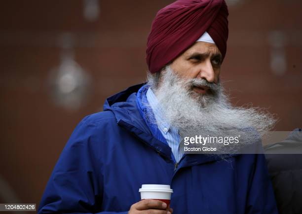The wind catches Inderpreet Singh's beard as he passes through the new pedestrian plaza in the Seaport District of Boston, MA on February 25, 2020....