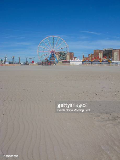The wind makes ripples on the sand in front of the closed Coney Island amusements in New York on 15 November 2013 15NOV13 [05JANUARY2014 TRAVEL POST...