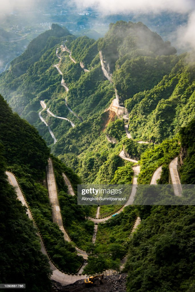 The winding road of Tianmen mountain national park (Zhangjiajie) in clouds mist, Hunan province, China : Stock Photo