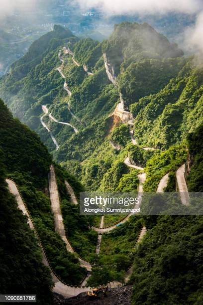 the winding road of tianmen mountain national park (zhangjiajie) in clouds mist, hunan province, china - tianmen stock pictures, royalty-free photos & images