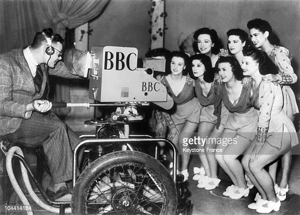 The WINDMILL girls pose for a closeup in front of the television camera during full rehearsal for Britain's television service of the BBC at...