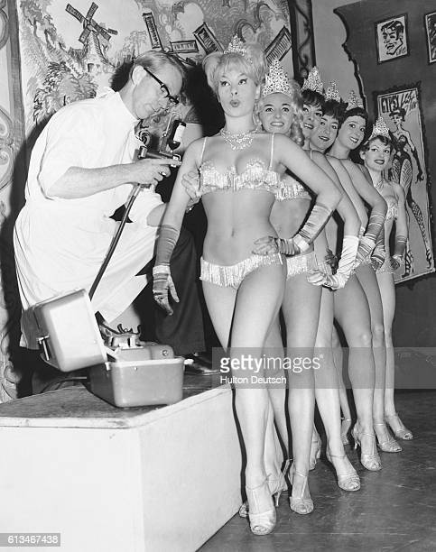 The Windmill Girls the showgirls from the Windmill Theatre are given influenza vaccinations from the Crookes Laboratories team so that they will not...
