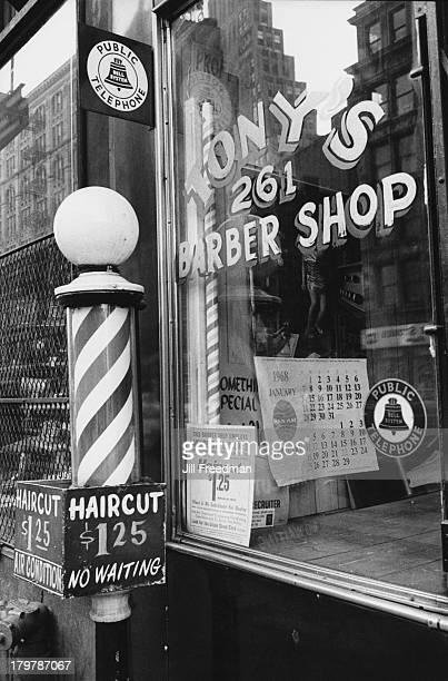 The window and barbers pole of Tony's Barber Shop in Little Italy Manhattan New York City 1968