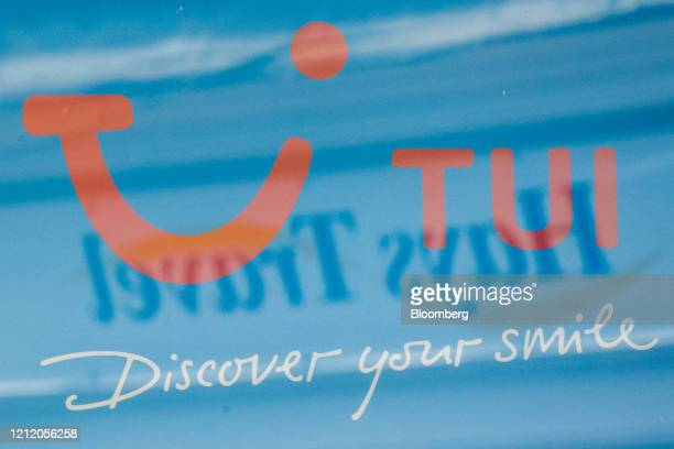 The window of a travel agency store, operated by Tui AG, reflects the logo of Hays Travel Ltd. In Canterbury, U.K., on Wednesday, May 6, 2020....