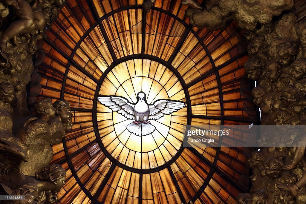 The window overlooking the main altar of St. Peter's Basilica featuring the Holy Spirit during the Pentecost Celebration presided by Pope Francis on May 24, 2015 in Vatican City, Vatican. Pope Francis presided over Mass in St Peter's Basilica this Pentecost Sunday saying that, the world needs men and women who are filled with the Holy Spirit. Pentecost, fifty days after Easter feast commemorates the descent of the Holy Spirit upon the Apostles.