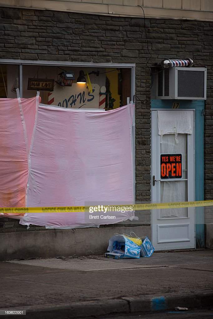 The windows of John's Barber Shop are obscured after a gunman opened fire inside on March 13, 2013 in Mohawk, New York. Police have identified 64-year-old Kurt Meyers as a possible suspect responsible for a total of four shooting deaths and two injuries across the area earlier in the day.