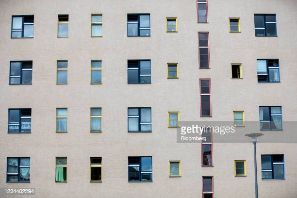 The windows of residential apartments on the Carl Legien modernist housing estate, operated by Deutsche Wohnen SE, in Berlin, Germany, on Monday,...