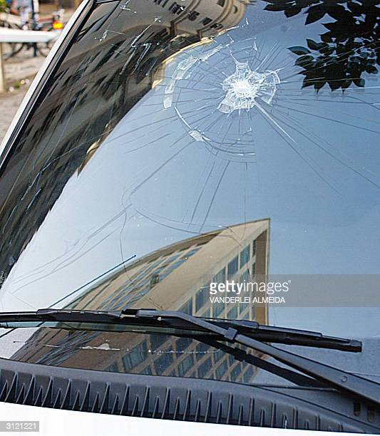 The windshield of an armored car attached to the US consulate in Rio de Janeiro Brazil shows 22 March 2004 a crack caused by the blast of a Molotov...