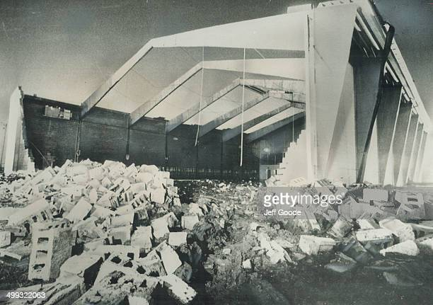 The windsor curling rink in which eight persons were killed and eleven injured had the roof ripped off and a wall demolished by a freak tornado...