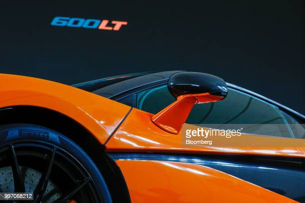 The wing mirror protrudes from the McLaren 600LT supercar manufactured by McLaren Automotive Ltd during its launch at the Goodwood Festival of Speed...