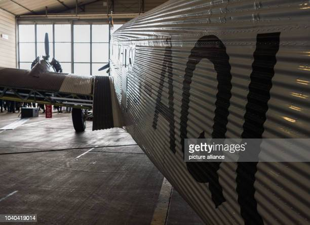 The wing of a historic Junkers Ju 52 aircraft in a hangar in Hamburg Germany 6 April 2017 The plane known colloquially as Aunt Ju is celebrating its...