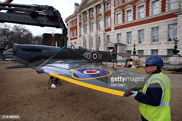The wing of a World War 2 Spitfire Mk XVI is fitted onto the body of the plane as it assembled at Horse Guards Parade on March 30 2016 in London...