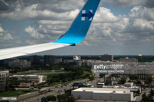 The wing of Democratic presidential nominee Hillary Clinton's plane can be seen as it arrives at Tampa International Airport September 6 2016 in...