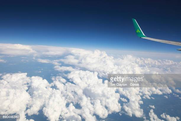 The wing tip and logo of an Aer Lingus airliner crossing the Atlantic ocean between Dublin Ireland and Hartford Connecticut Aer Lingus is the flag...