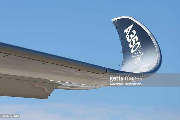 The wing tip of a new Airbus A350X WB passenger plane on the tarmac at Munich Airport during a presentation of the new plane by Airbus officials on...