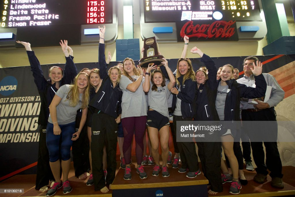 The Wingate University team receives their third place trophy during the Division II Men's and Women's Swimming & Diving Championship held at the Birmingham CrossPlex on March 11, 2017 in Birmingham, Alabama.