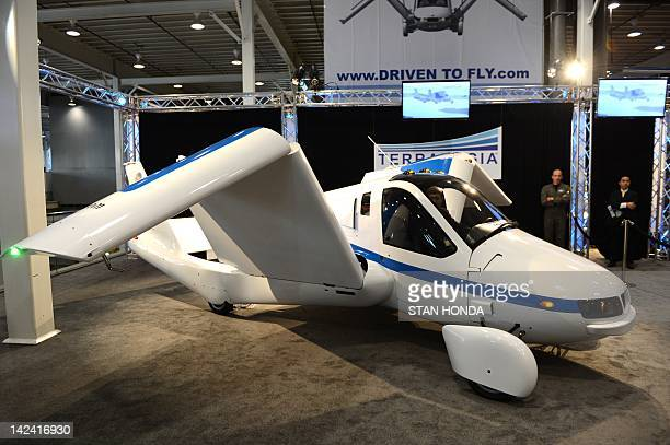 The wings fold up in a demonstration of the Terrafugia 'Flying Car' during the first day of press previews at the New York International Automobile...